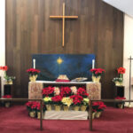 alter decorated with red flowers
